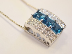 Sterling Silver Blue Topaz Pendant with Round Cubic Zirconia